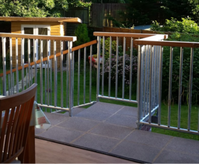 Galvanised tube with wooden handrail