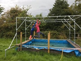 Monkey bars over water